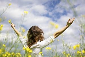 girl-field-of-yellow-flowers